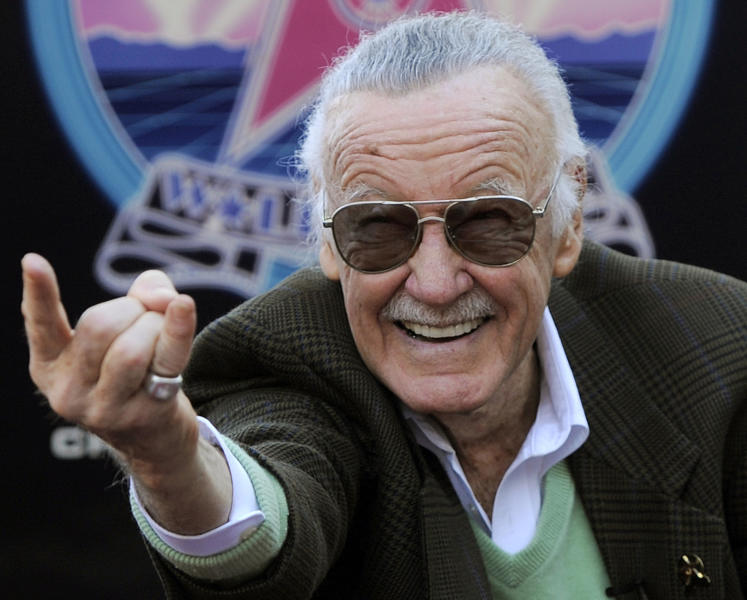 FILE - In this Jan. 4, 2011 file photo, Comic book creator Stan Lee strikes the Spiderman pose as he poses after receiving a star on the Hollywood Walk of Fame in Los Angeles. A former business manager of Stan Lee has been arrested on elder abuse charges involving the late comic book icon. Los Angeles police say Keya Morgan was taken into custody in Arizona early Saturday, May 25, 2019, on an outstanding arrest warrant. Morgan was charged earlier this month with felony allegations of theft, embezzlement, forgery or fraud against an elder adult, and false imprisonment of an elder adult. (AP Photo/Chris Pizzello, File)