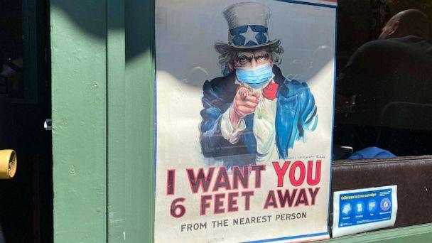 PHOTO: The iconic 'I Want You for U.S. Army' Uncle Sam poster is seen wearing a mask and demanding people to stand six feet away in San Francisco, California, on July 31, 2020. (Daniel Slim/AFP via Getty Images)