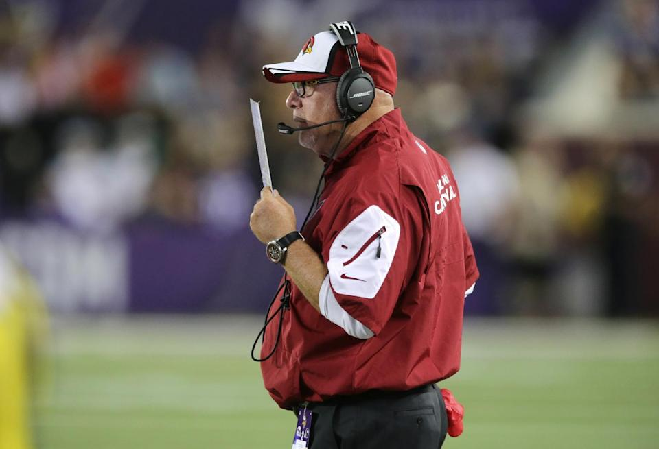 Arizona Cardinals head coach Bruce Arians stands on the sideline during the second half of an NFL preseason football game against the Minnesota Vikings, Saturday, Aug. 16, 2014, in Minneapolis. (AP Photo/Jim Mone)