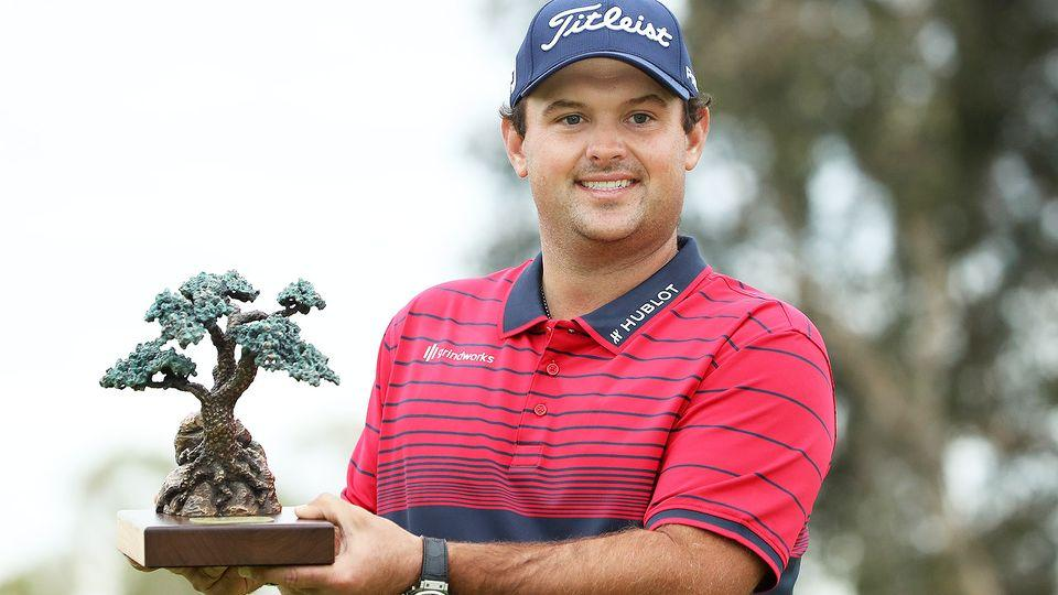 Seen here, Patrick Reed holds the Farmers Insurance Open trophy aloft.