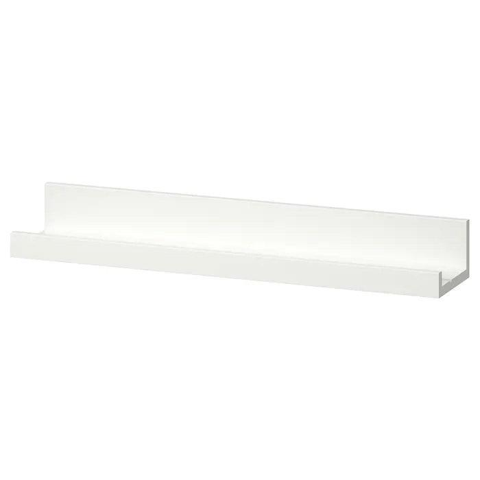 """For an affordable wall mount option, Nepacena suggests these picture ledge shelves, which she uses frequently for organizing office supplies. She likes that these are """"pretty to look at"""" and great for storing """"small containers with items such as pencils, pens, and paper clips."""" You can even get creative with your ledge arrangement for a customized wall accent. $10, IKEA. <a href=""""https://www.ikea.com/us/en/p/mosslanda-picture-ledge-white-40291766/"""" rel=""""nofollow noopener"""" target=""""_blank"""" data-ylk=""""slk:Get it now!"""" class=""""link rapid-noclick-resp"""">Get it now!</a>"""