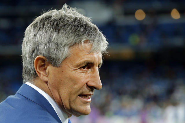 FILE - In this Wednesday, March 1, 2017 file photo, Las Palmas coach Quique Setien waits for the start of a Spanish La Liga soccer match between Real Madrid and Las Palmas at the Santiago Bernabeu stadium in Madrid, Spain. Seten will be at the Camp Nou Stadium on Tuesday Jan. 14, 2020 to be officially introduced as the new coach of Barcelona, the club that for so long inspired his vision of soccer. (AP Photo/Paul White, File)