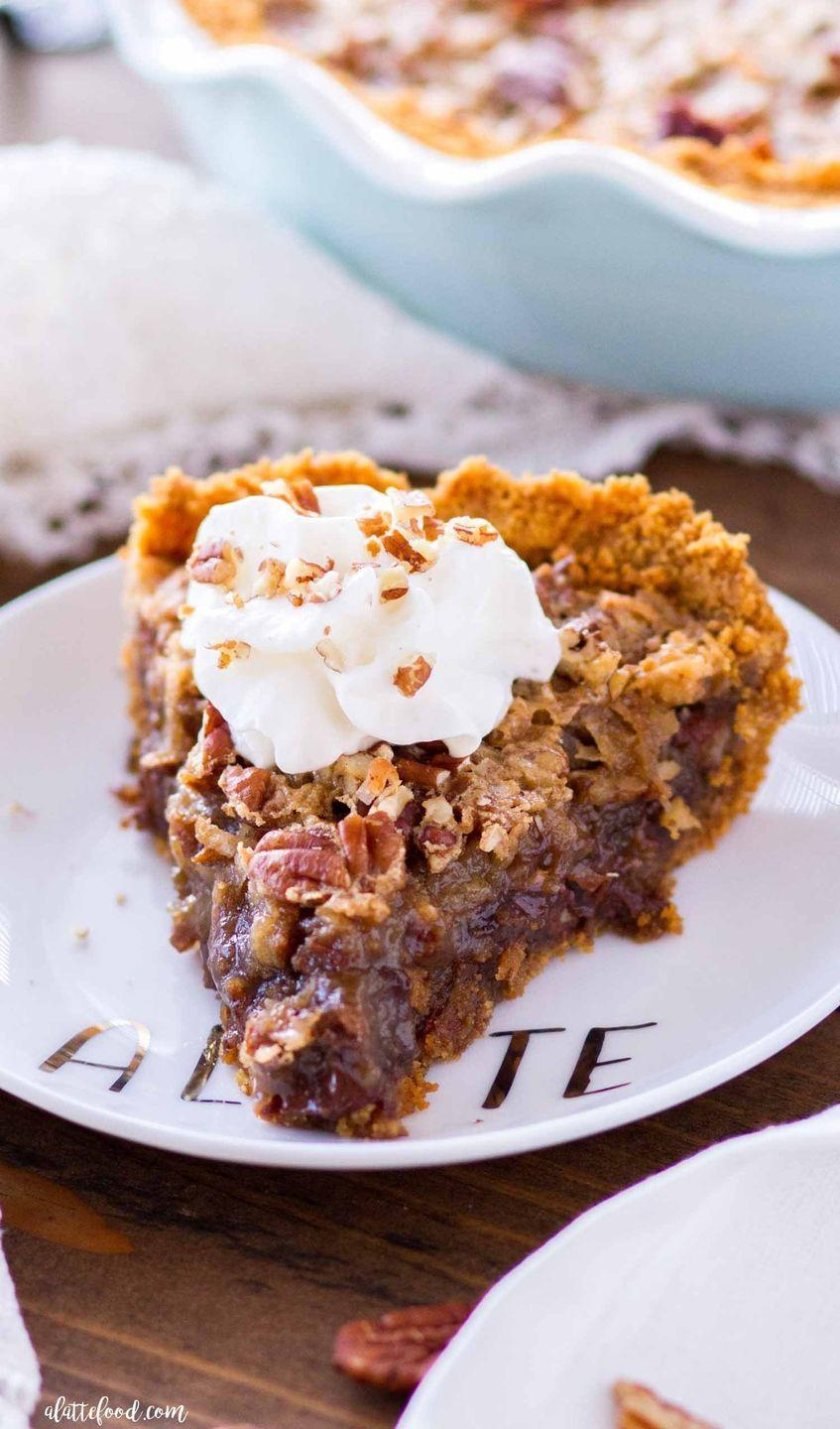 """<p>Sorry, Grandma—this pecan pie puts all other recipes to shame. The addition of chocolate and coconut is irresistible.</p><p><strong>Get the recipe at <a href=""""https://www.alattefood.com/german-chocolate-pecan-pie-graham-cracker-crust/"""" rel=""""nofollow noopener"""" target=""""_blank"""" data-ylk=""""slk:A Latte Food"""" class=""""link rapid-noclick-resp"""">A Latte Food</a>.</strong> </p>"""