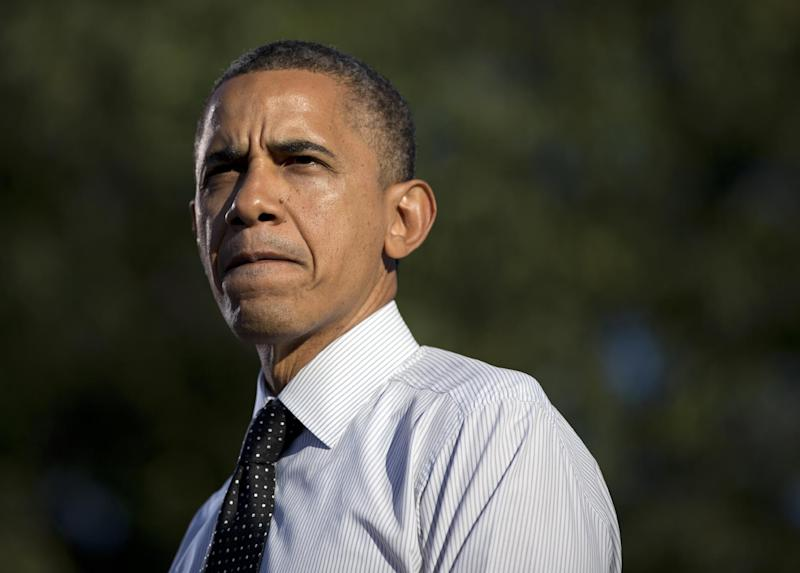 President Barack Obama pauses as he speaks at a campaign event at The Ohio State University Oval, Tuesday, Oct. 9, 2012, in Columbus, Ohio. (AP Photo/Carolyn Kaster)