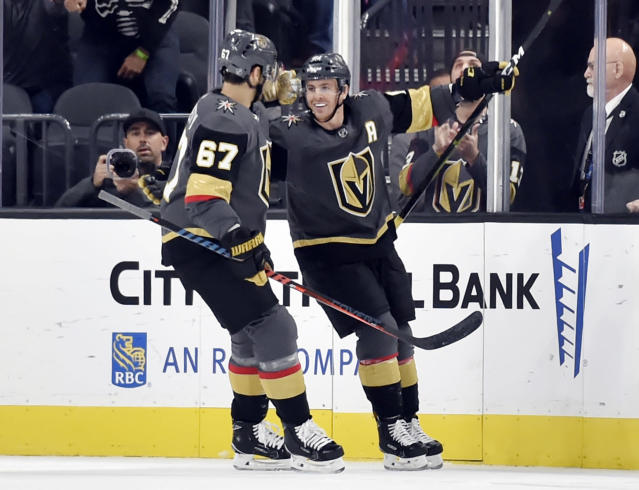 Vegas Golden Knights left wing Max Pacioretty (67) and center Jonathan Marchessault (81) react after Marchessault's goal during the first period of an NHL hockey game against the Buffalo Sabres, Tuesday, Oct. 16, 2018, in Las Vegas. (AP Photo/David Becker)