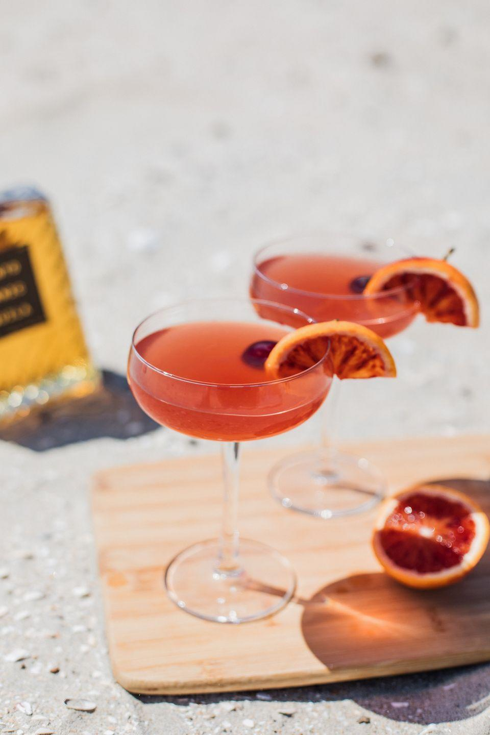 <p>Perfect for golden hour and beyond, this simple cocktail is perfect for any occasion—and feels festive enough to serve in winter. </p><p><strong>Ingredients:</strong></p><p>2 ounces Solento Añejo</p><p>2 ounces blood orange juice</p><p>ice</p><p>sparkling mineral water</p><p> blood orange slices and Luxardo cherries, for garnish</p><p><strong>Directions:</strong></p><p>Combine tequila, blood orange juice, and ice in a cocktail shaker and shake, Serve into a coupe glass, top with sparkling mineral water, and garnish with a blood orange slice and Luxardo cherry. </p>