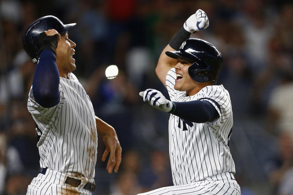 New York Yankees' Gio Urshela, right, celebrates his two- run home run with Aaron Judge, left, during the third inning of a baseball game against the Boston Red Sox, Sunday, Aug. 4, 2019, in New York. (AP Photo/Adam Hunger)