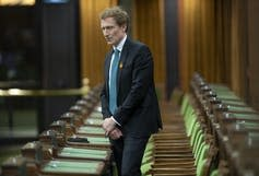 Indigenous Services Minister Marc Miller stands during a moment of silence in the House of Commons.