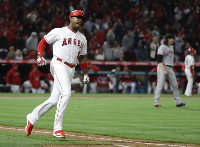 Los Angeles Angels' Justin Upton reacts after flying out with the bases loaded to end the fifth inning a baseball game against the San Francisco Giants in Anaheim, Calif., Friday, April 20, 2018. (AP Photo/Chris Carlson)