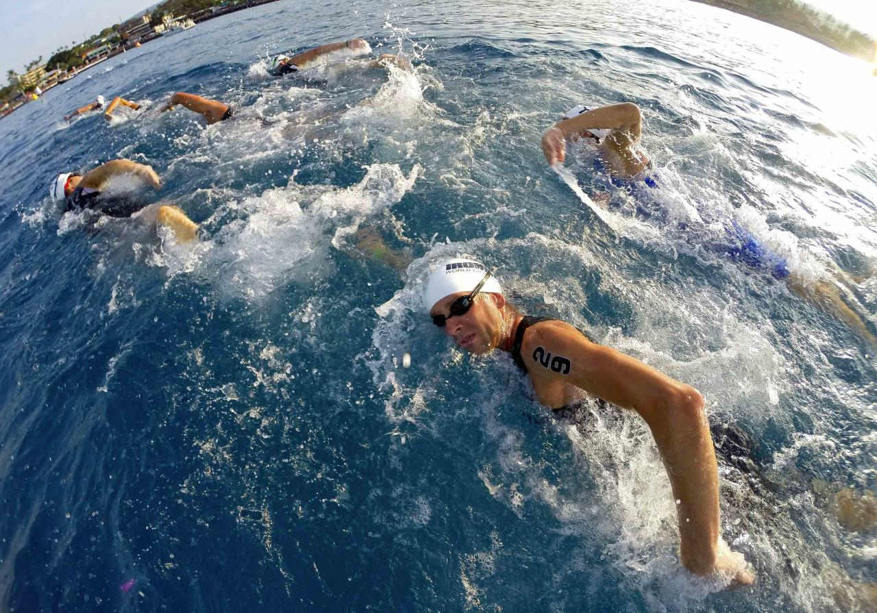 Professional male triathlete Jordan Rapp (29) of the U.S. swims to the transition area during the 2.4 miles (3.86 km) swim portion of the Ironman World Championship in Kailua-Kona, Hawaii, October 12, 2013. REUTERS/Hugh Gentry (UNITED STATES - Tags: SPORT TRIATHLON TPX IMAGES OF THE DAY)