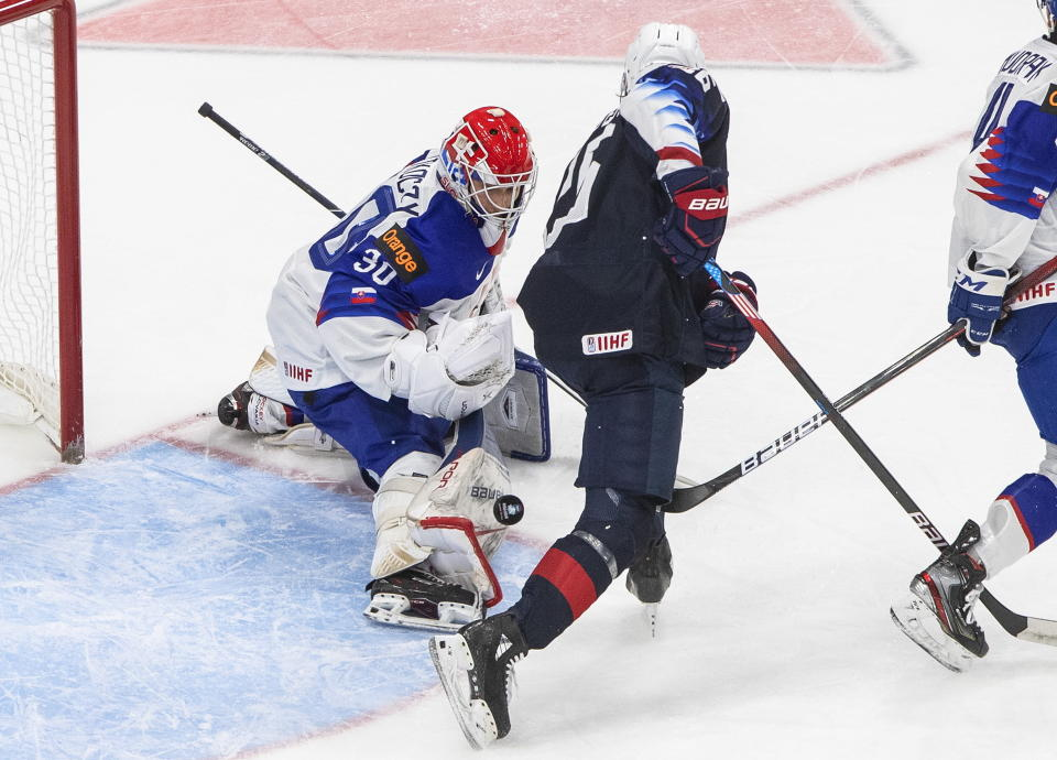 United States' Landon Slaggert (26) is stopped by Slovakia goalie Simon Latkoczy (30) during the first period of an IIHL World Junior Hockey Championship game, Saturday, Jan. 2, 2021 in Edmonton, Alberta. (Jason Franson/The Canadian Press via AP)