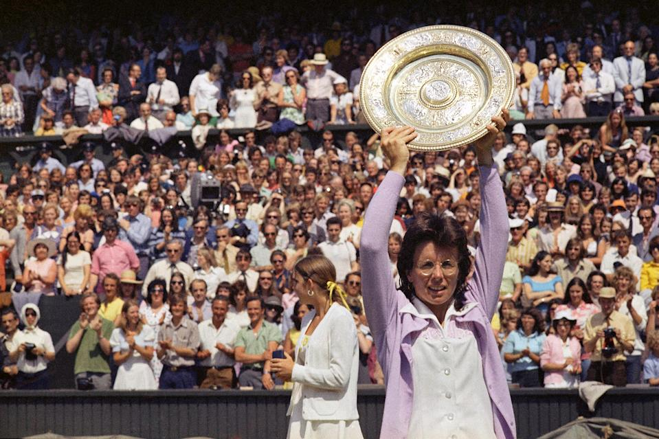 Billie Jean King holds up the championship trophy after defeating Chris Evert in the Wimbledon women's singles final in 1973. This was King's fifth time winning Wimbledon.