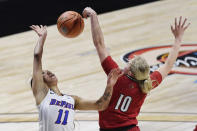 Louisville's Hailey Van Lith, right, blocks a shot attempt by DePaul's Sonya Morris during the first half of an NCAA college basketball game Friday, Dec. 4, 2020, in Uncasville, Conn. (AP Photo/Jessica Hill)
