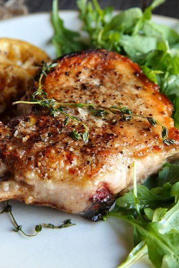 "<p>This pork has got mad flavour chops. </p><p>Get the <a href=""https://www.delish.com/uk/cooking/recipes/a33641901/pork-chops-with-warm-lemon-vinaigrette-recipe/"" rel=""nofollow noopener"" target=""_blank"" data-ylk=""slk:Pork Chops with Warm Lemon Vinaigrette"" class=""link rapid-noclick-resp"">Pork Chops with Warm Lemon Vinaigrette</a> recipe.</p>"