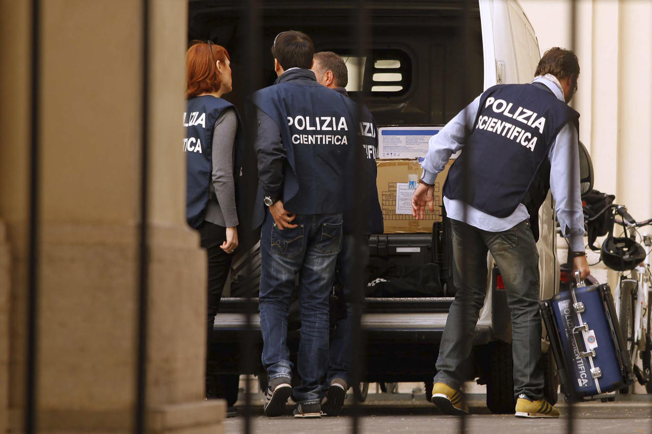 Forensic police unload equipment in the courtyard of Sant' Apollinare Basilica, in Rome, Monday, May 14, 2012. Indications mounted Monday that the tomb of reputed mobster Enrico De Pedis was to be opened inside the basilica as part of an investigation into one of the Vatican's enduring mysteries: the 1983 disappearance of the teenage daughter of a Vatican employee, Emanuela Orlandi. (AP Photo/Roberto Monaldo, Lapresse) ITALY OUT