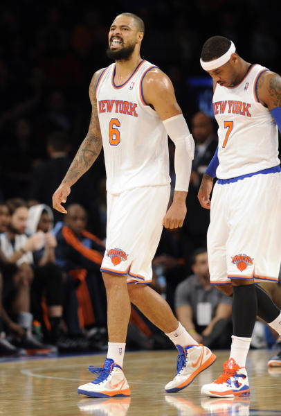 New York Knicks' Tyson Chandler (6) walks off the court with Carmelo Anthony after Chandler injured his leg during the first quarter of an NBA basketball game against the Charlotte Bobcats on Tuesday, Nov. 5, 2013, at Madison Square Garden in New York. (AP Photo/Bill Kostroun)