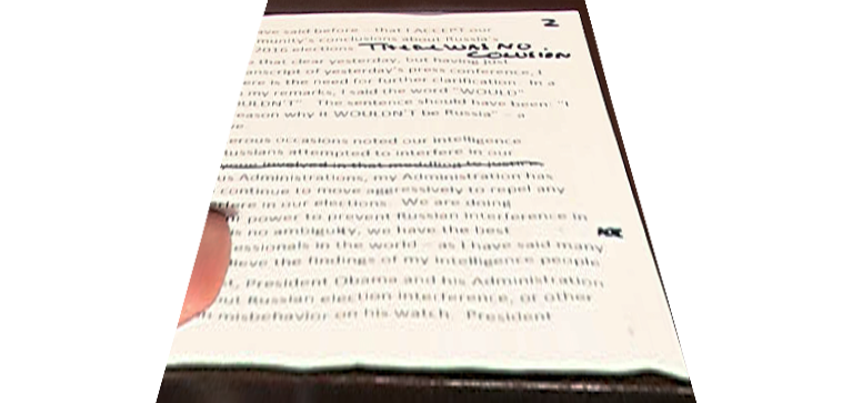 "A close-up of Trump's ""There was no colusion"" note. (Getty)"