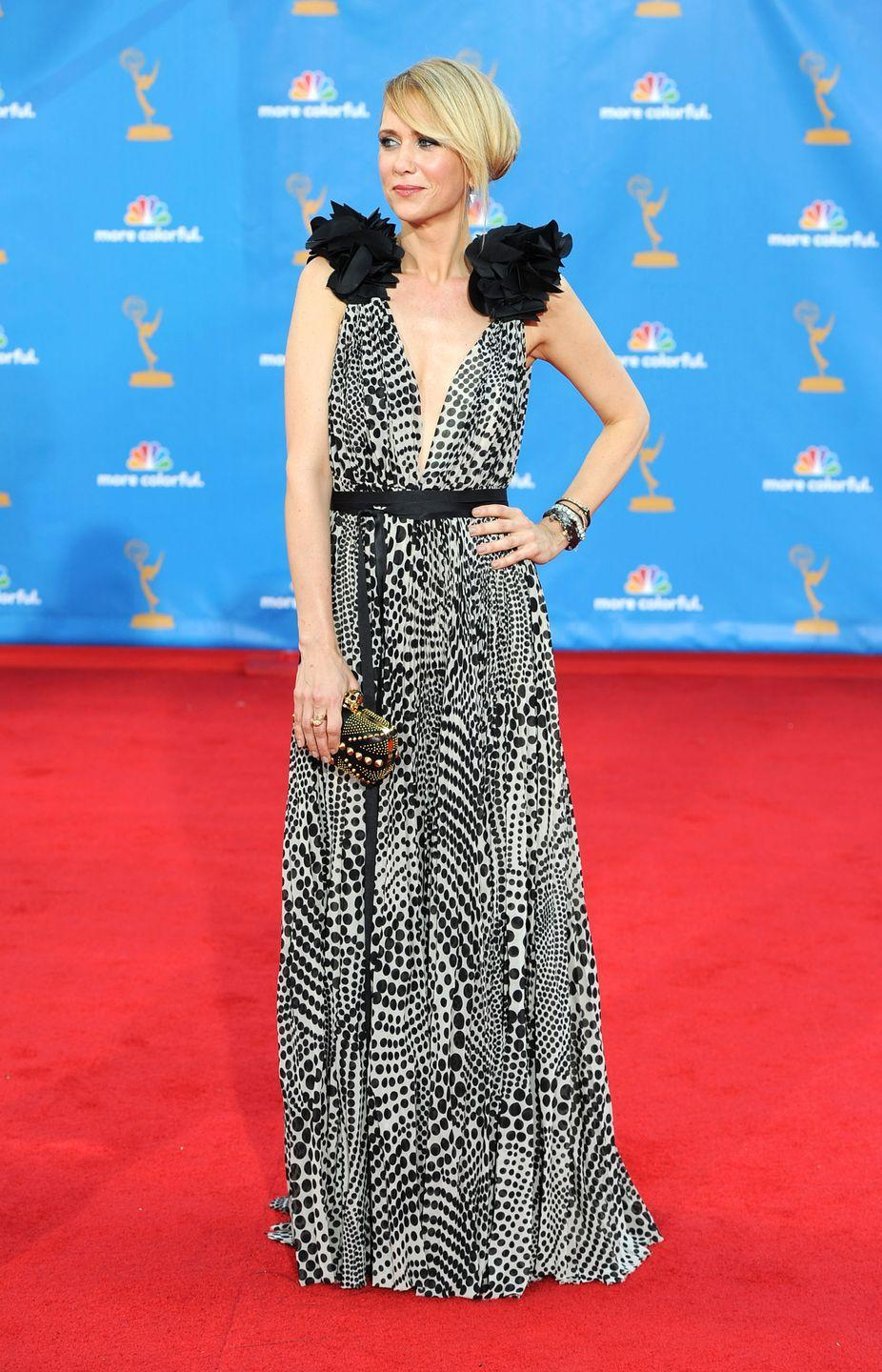 <p>Wiig stood out in this printed floor-length dress at the Emmy Awards in 2010.</p>