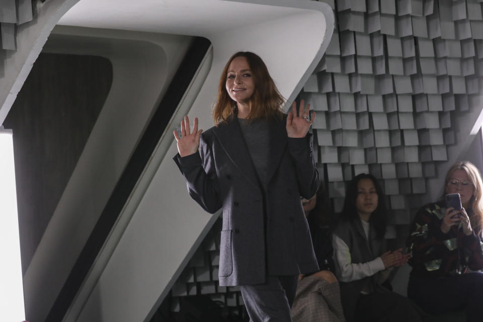 Stella McCartney accepts applause at the conclusion of her Spring-Summer 2022 ready-to-wear fashion show presented in Paris, Monday, Oct. 4, 2021. (Photo by Vianney Le Caer/Invision/AP)