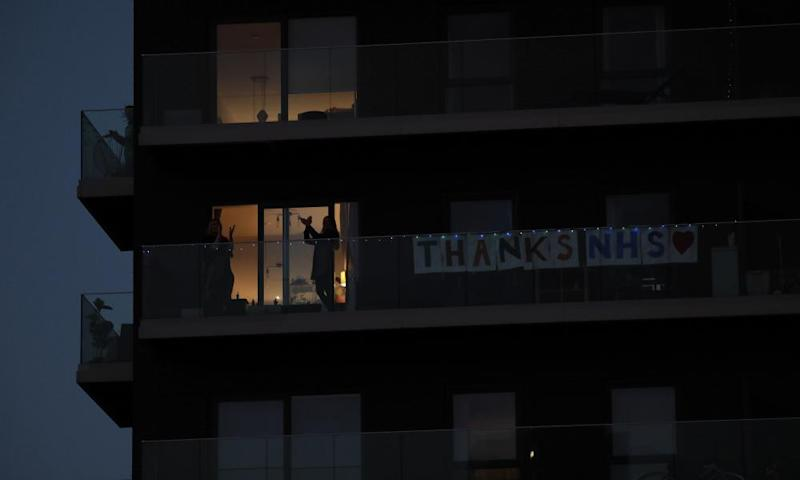 Applause for the NHS from balconies in Stratford, east London.