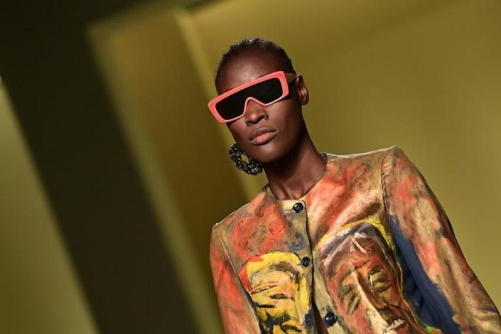 """A model presents a creation by Senegalese fashion designer, Pape Mocodou Fall, aka Mokodu from the collective """"Black Lives Matter in Italian Fashion"""" in Milan during the filming of the fashion show that opened the Milan Fashion Week on Wednesday."""