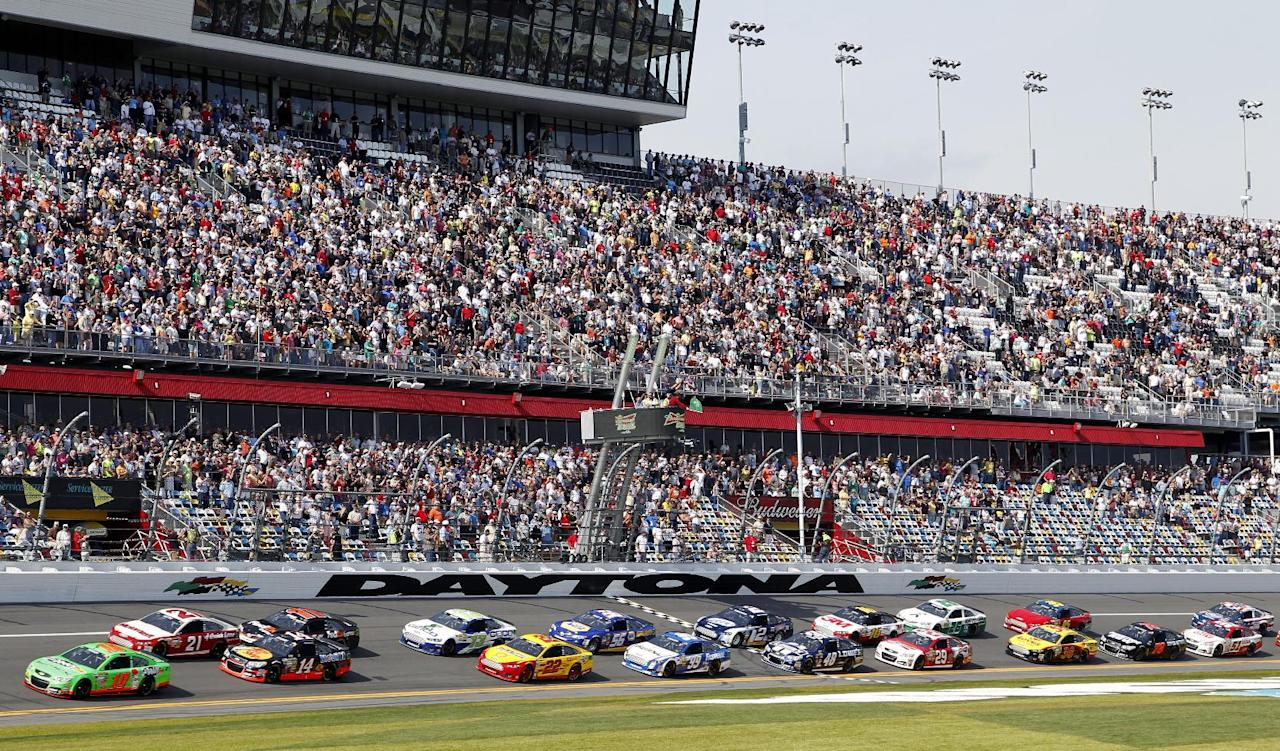 Danica Patrick, far left, leads the field at the start of the first of two 150-mile qualifying races for the NASCAR Daytona 500 auto race at Daytona International Speedway, Thursday, Feb. 21, 2013, in Daytona Beach, Fla. (AP Photo/Terry Renna)