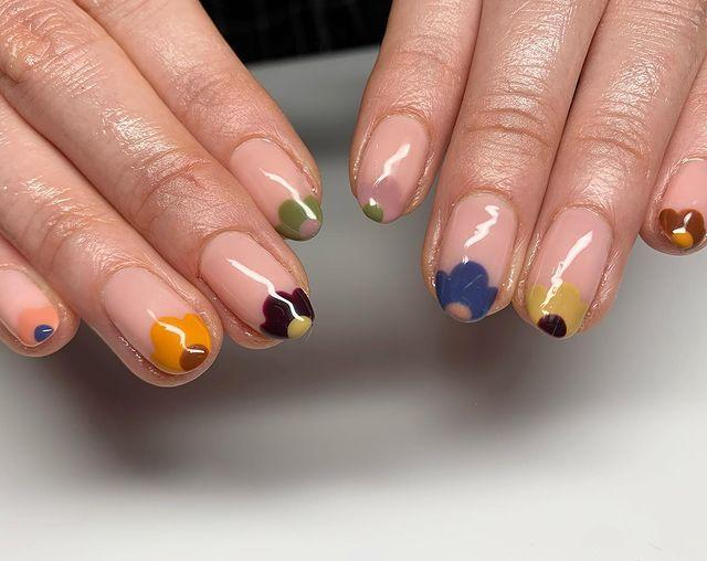 """<p>No matter how keen you are to celebrate winter ending, if you don't do it right, flowers can feel a bit passé in nail art. Also, it's super fiddly if you're going DIY. <br><br>This pretty Orla Kielyesque 70s vibe is a perfect way round the issue if you're keen to lean into florals for spring. Pick muted tertiary colours like pistachio, mustard and peach, and mix them up when adding flower heads to the tips of your nails, scaling the petals according to the size of the nail.</p><p><a href=""""https://www.instagram.com/p/CJAza_ZlqlY/"""" rel=""""nofollow noopener"""" target=""""_blank"""" data-ylk=""""slk:See the original post on Instagram"""" class=""""link rapid-noclick-resp"""">See the original post on Instagram</a></p>"""