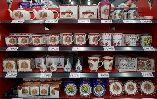 """Souvenirs commemorating Queen Elizabeth II's diamond jubilee are displayed in a London shop. """"We sell an enormous amount from our online shop to customers from North America and the Commonwealth countries,"""" a retailer said"""