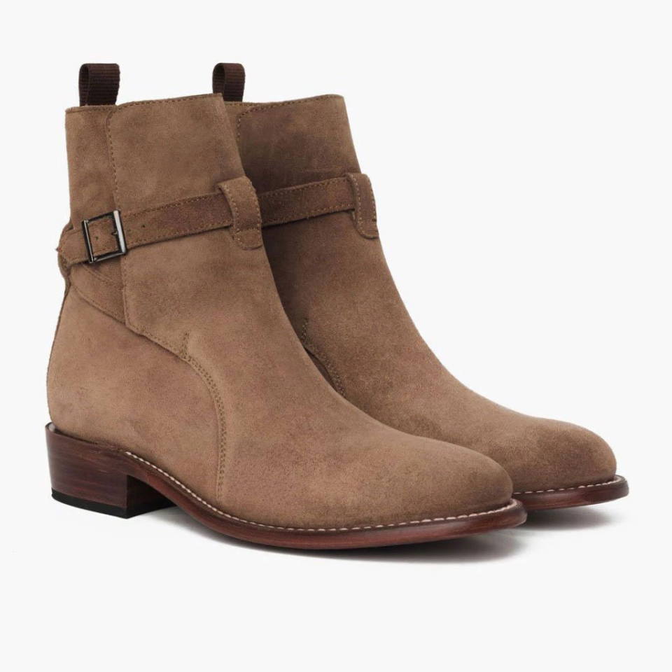 """<em><strong>Brittany Talarico, Senior Style Editor</strong></em>: My husband's shoe closet rivals my own, so any time I find a brand he doesn't know about, I add them to the top of the gift list. Thursday Boot Co. offers all the latest shoe styles and trends for men (and women!) at accessible prices. This Jodphpur pair is in my cart right now and will be wrapped under the tree as soon as they arrive. (I also <a href=""""https://thursdayboots.com/products/womens-heartbreaker-high-heel-bootie-black?collection=womens-boots-booties"""" target=""""_blank"""">snagged the cutest black booties</a> for myself!)  <strong>Buy It! </strong>Thursday Boot Co. Men's Taupe Suede Rogue Jodhpur Boots, $199; <a href=""""https://thursdayboots.com/products/mens-rogue-jodhpur-boot-taupe-suede?collection=boots"""" target=""""_blank"""">thursdayboots.com</a>"""