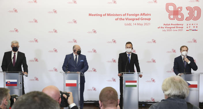 Slovak Foreign Minister Ivan Korcok, left, Polish Foreign Minister Zbigniew Rau, Hungarian Foreign Minister Peter Szijjarto and Czech Republic Foreign Minister Tomas Petricek, right, attend a press conference after the foreign ministers of the Visegrad Group ,V4, in Lodz, Poland, Friday, May 14, 2021.(AP Photo/Czarek Sokolowski)