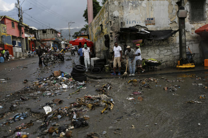 Debris litters a street caused by a flood of water brought on by heavy rains that fell over Port-au-Prince, Haiti, Friday, July 9, 2021, two days after Haitian President Jovenel Moise was assassinated in his home. (AP Photo/Fernando Llano)