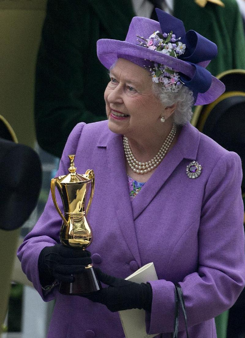 Britain's Queen Elizabeth II with a trophy after her horse Estimate won the Gold Cup, during day three of the Royal Ascot meeting, at Ascot Racecourse, in Ascot, England, England, Thursday, June 20, 2013. (AP Photo/Alastair Grant)