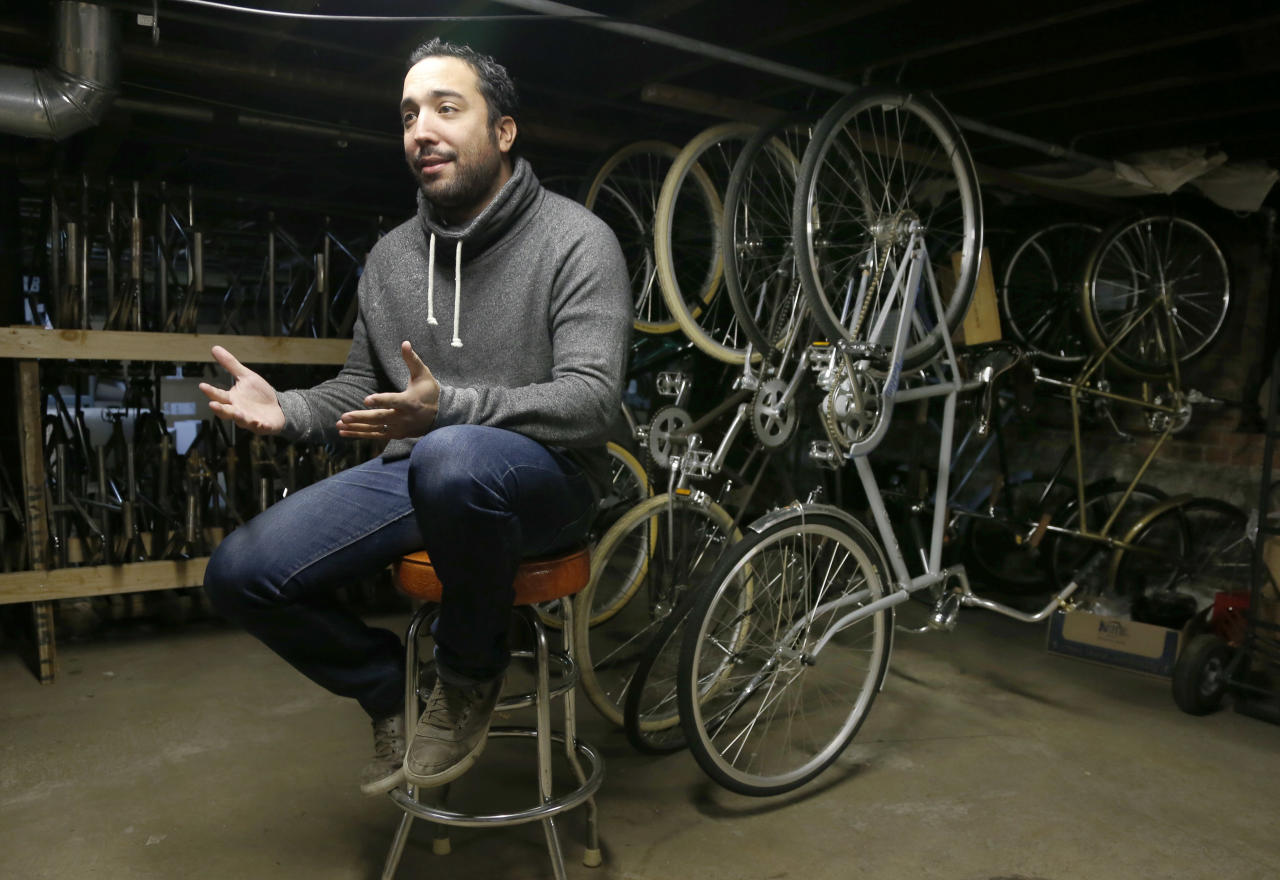 "In this photo taken Tuesday, Dec. 17, 2013, in Chicago, Mike Salvatore, owner of Heritage Bicycles talks about the emerging increase in bike riders at his Lakeview neighborhood store. A recent debate on a proposed city bicycle tax has put the spotlight back on cycling. Salvatore believes that no one would have taken that proposal seriously 10 years ago. ""Why would you tax bikers, who bikes?! Seriously, 10 years ago there was a handful of nutcases who biked around Chicago. No one would have taken it seriously."" (AP Photo/Charles Rex Arbogast)"