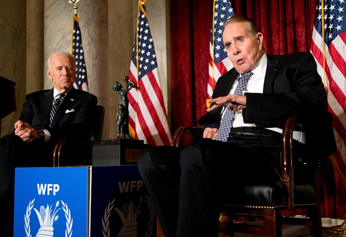 Bob Dole, right, is presented with the McGovern-Dole Leadership Award by then-Vice President Joe Biden in 2013.