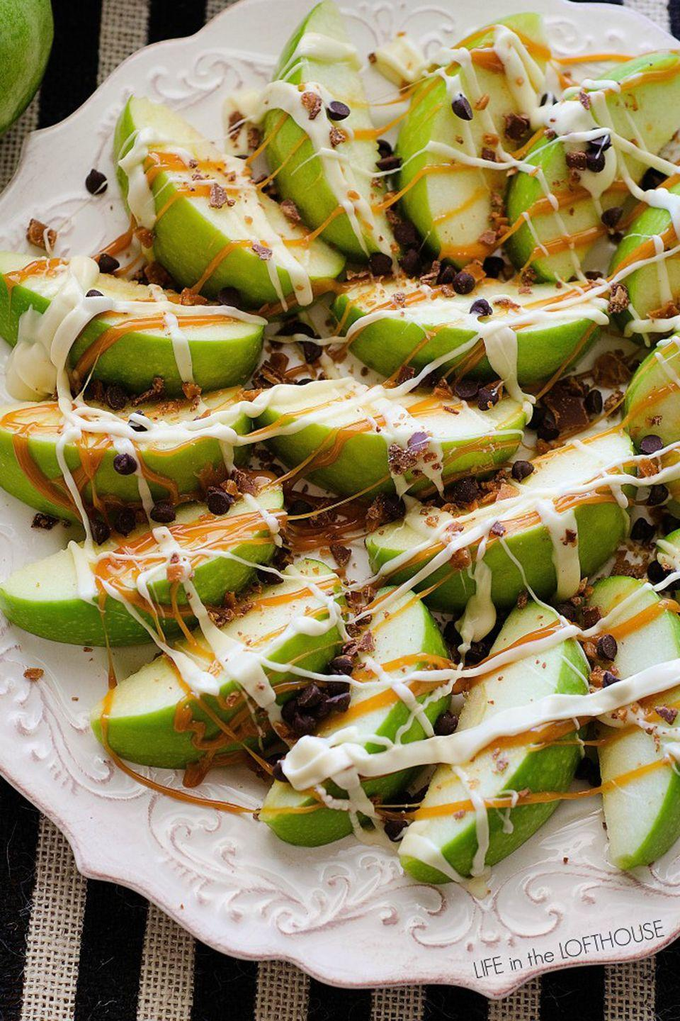 """<p>This sweet spin turns your favorite game day snack into a delightful dessert.</p><p><strong>Get the recipe at <a href=""""https://life-in-the-lofthouse.com/caramel-apple-nachos/"""" rel=""""nofollow noopener"""" target=""""_blank"""" data-ylk=""""slk:Life In the Lofthouse"""" class=""""link rapid-noclick-resp"""">Life In the Lofthouse</a>.</strong></p>"""