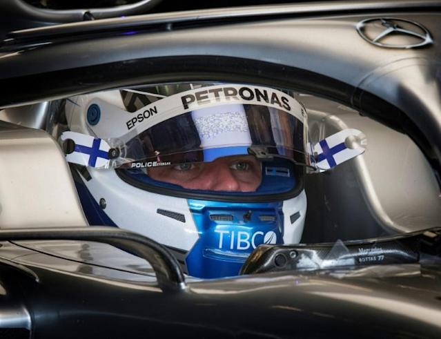Valtteri Bottas plots his pole position drive in the pits (AFP Photo/Mark RALSTON)