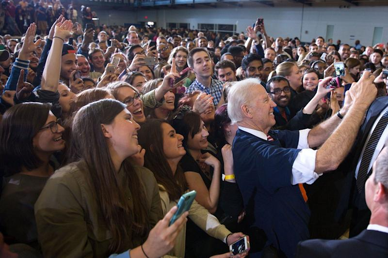 <br />Biden&nbsp;takes a selfie with students, following an &ldquo;It&rsquo;s On Us&rdquo; event at the University of Illinois in Urbana, Illinois, on April 23, 2015.