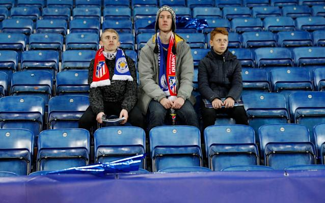 <span>Journey's end: some Leicester fans could not drag themselves from the stadium</span> <span>Credit: Reuters </span>