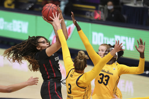 Stanford's Haley Jones (30) shoots against California's Fatou Samb (33) and Dalayah Daniels (3) during the first half of an NCAA college basketball game, Sunday, Dec. 13, 2020, in Berkeley, Calif. (AP Photo/Jed Jacobsohn)