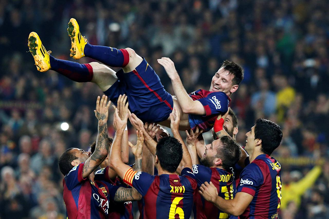 FILE PHOTO - Barcelona's Lionel Messi celebrates his second goal with teammates during their Spanish first division soccer match against Sevilla at Nou Camp stadium in Barcelona November 22, 2014.   REUTERS/Gustau Nacarino/File Photo