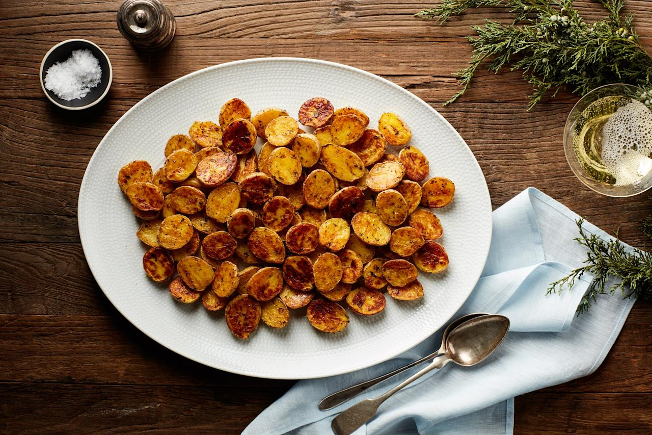 """These easy, crispy potatoes are ideal for a holiday meal. Tossing them with fresh thyme and nutmeg boosts their flavor (and makes your house smell amazing). Offer our horseradish-yogurt sauce on the side if you like! <a href=""""https://www.epicurious.com/recipes/food/views/crispy-baby-yukon-gold-potatoes?mbid=synd_yahoo_rss"""">See recipe.</a>"""