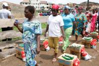 Women queue for food parcels during distribution by volunteers of the Lagos food bank initiative in a community in Oworoshoki, Lagos