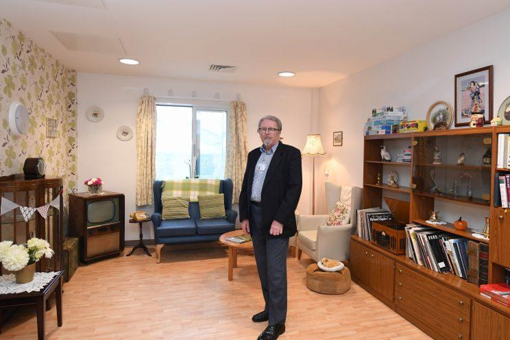 George in the room he decorated for his late wife (Wales News)