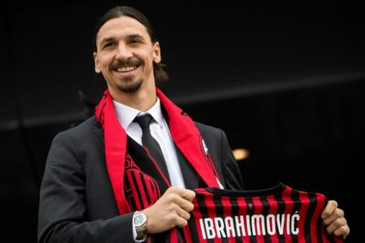 Swedish forward Zlatan Ibrahimovic poses with his new jersey during his official presentation with AC Milan
