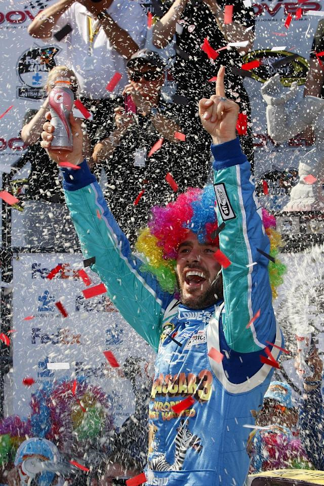 Jimmie Johnson (48) celebrates in victory lane after winning the NASCAR Sprint Cup Series FedEx 400 auto race at Dover International Speedway, Sunday, June 3, 2012, in Dover, Del. (AP Photo/LAT, Lesley Ann Miller) MANDATORY CREDIT