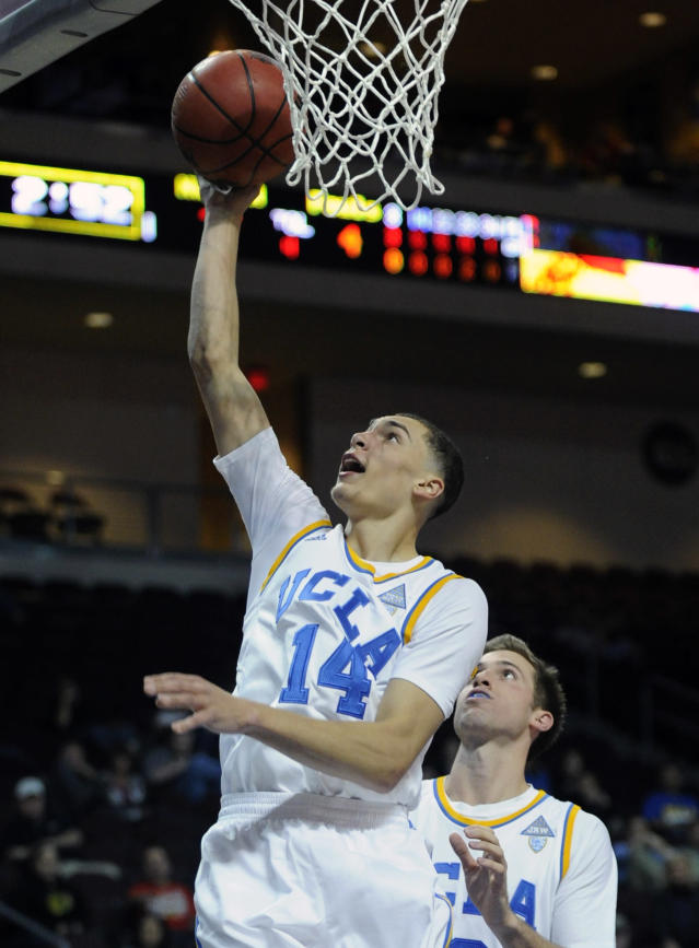 UCLA's Zach LaVine (14) lays up a shot against Northwestern during the first half of an NCAA college basketball game at the Las Vegas Invitational on Friday, Nov. 29, 2013, in Las Vegas. (AP Photo/David Becker)
