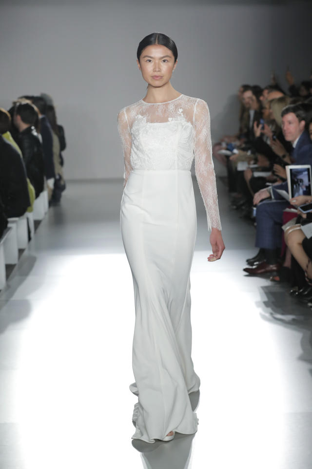 <p>Perfect for the minimalist bride, the lace details on this dress show just enough skin without being too revealing.</p>
