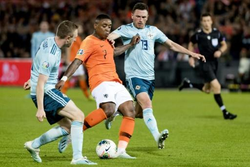 Tottenham's major move of the window was the signing of Dutch internationaln winger Steven Bergwijn (centre)
