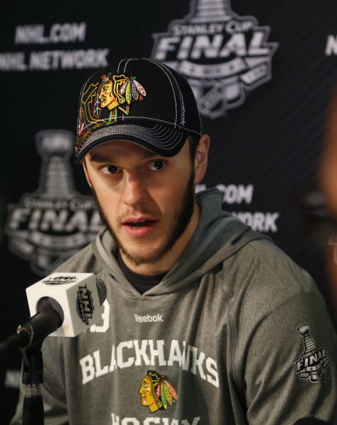 Chicago Blackhawks center Jonathan Toews responds to a question during a news conference for the Stanley Cup Final hockey series against the Boston Bruins Tuesday, June 11, 2013 in Chicago. The first game of the Stanley Cup final series is Wednesday in Chicago. (AP Photo/Charles Rex Arbogast)