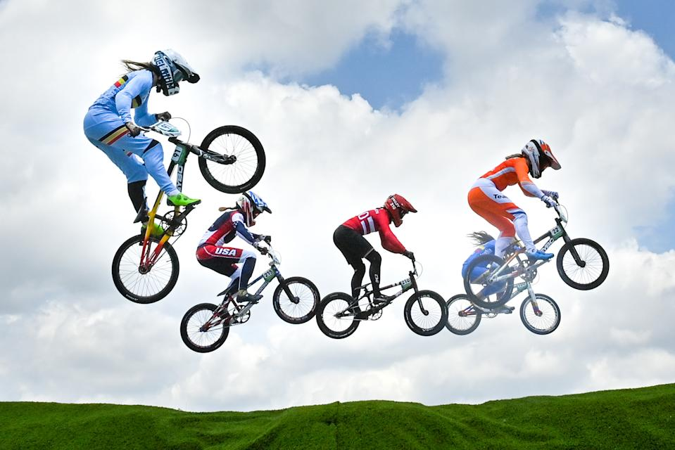 <p>Belgian Elke Vanhoof (L) pictured in action during the quarter finals of the women's BMX cycling competition on the seventh day of the 'Tokyo 2020 Olympic Games' in Tokyo, Japan on Thursday 29 July 2021. The postponed 2020 Summer Olympics are taking place from 23 July to 8 August 2021. (Photo by DIRK WAEM/BELGA MAG/AFP via Getty Images)</p>